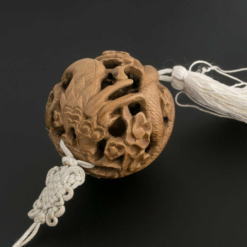 Vintage Chinese carved walnut shell pendant on cord with tassel. b7-wo258(e)