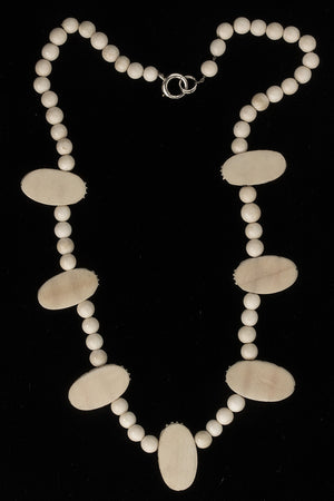 nliv867- Vintage carved ivory scarab necklace, 1970s.