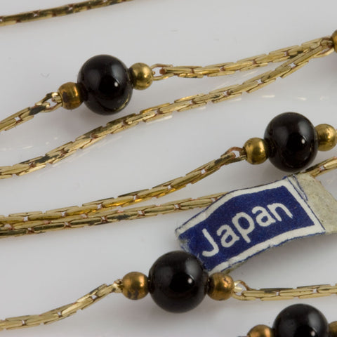 Vintage brass snake chain with black glass and brass beads in 24