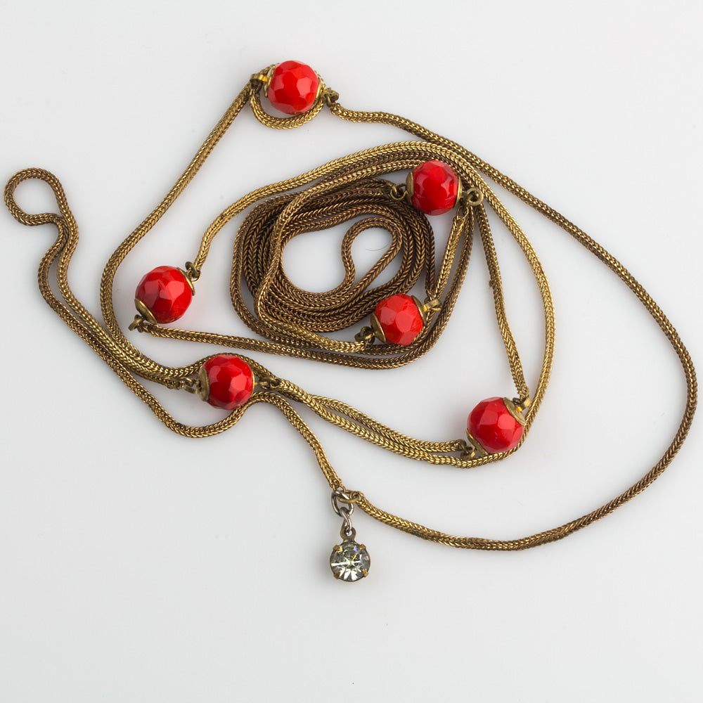 Art Deco long rope necklace with brass foxtail chain and red glass beads. nlad880