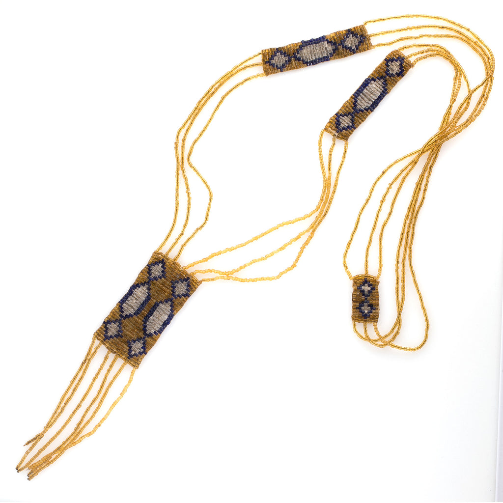 1920s flapper period woven glass seed bead necklace in gold, crystal and blue beads with fringe. nlad973