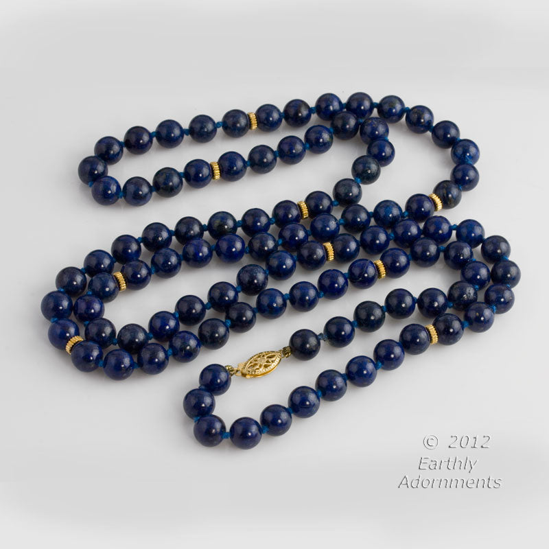 Vintage opera length necklace of AA quality lapis lazuli beads with 14k beads and clasp. nlbd1053