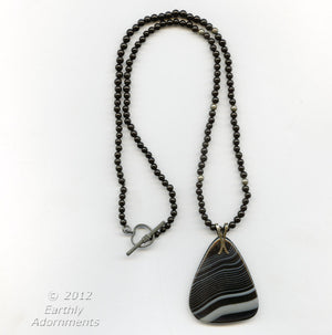 Banded agate pendant and black onyx bead necklace. nlbd1064(e)