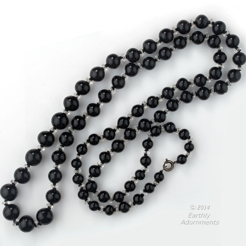 Vintage Art Deco graduated and knotted black onyx and crystal bead necklace. nlbd1170