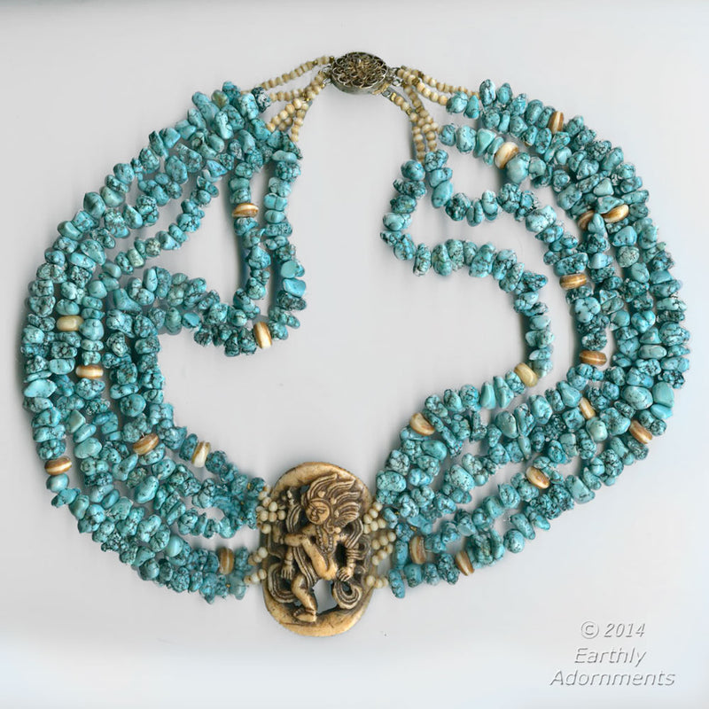 Vintage multistrand blue turquoise and yak bone necklace with Tibetan carved deity amulet centerpiece. nlbd1119
