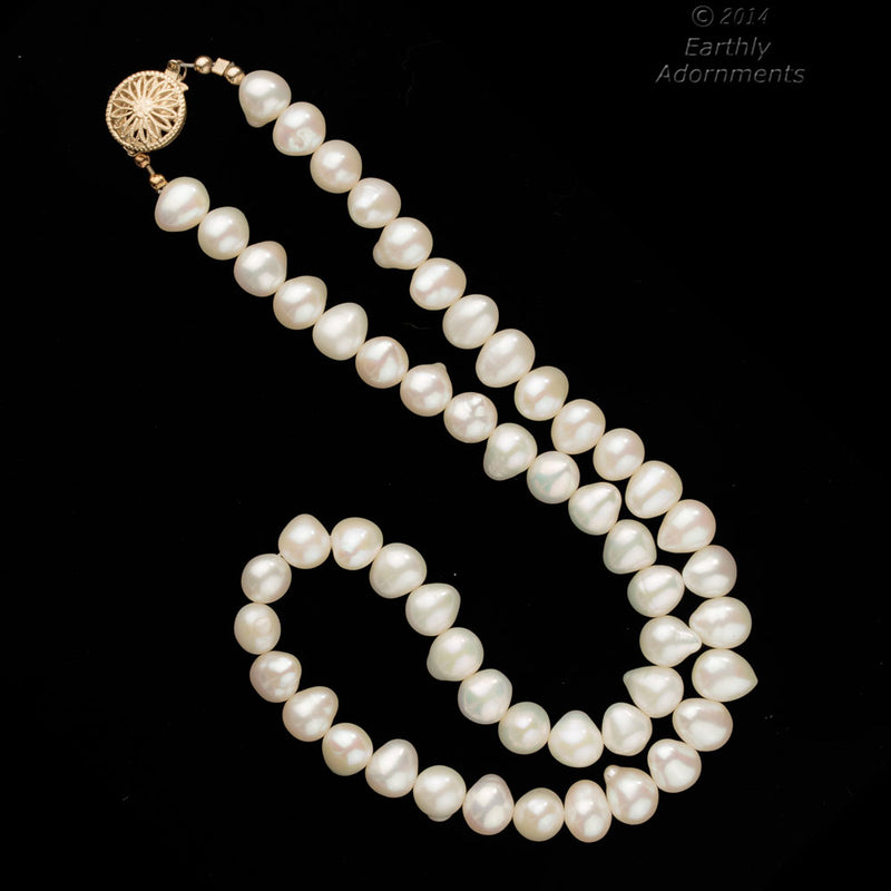 Vintage necklace of natural freshwater pear shape baroque pearls. nlbd1161sb