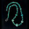 Necklace of vintage rare carved and smooth natural turquoise beads with sterling silver spacers and clasp.  nlbd1265
