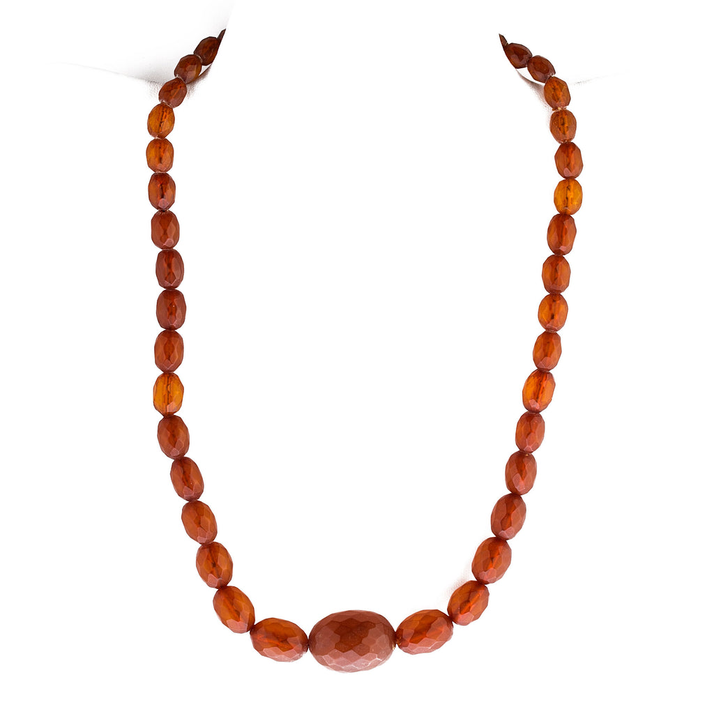 Antique Art Deco faceted Cognac color Baltic amber bead necklace.  21.5 inches. nlbd1269