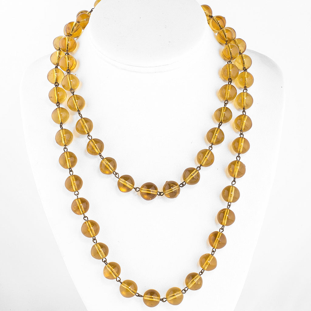 1920s Bohemian amber glass bead necklace. 40 inches . nlbd1275
