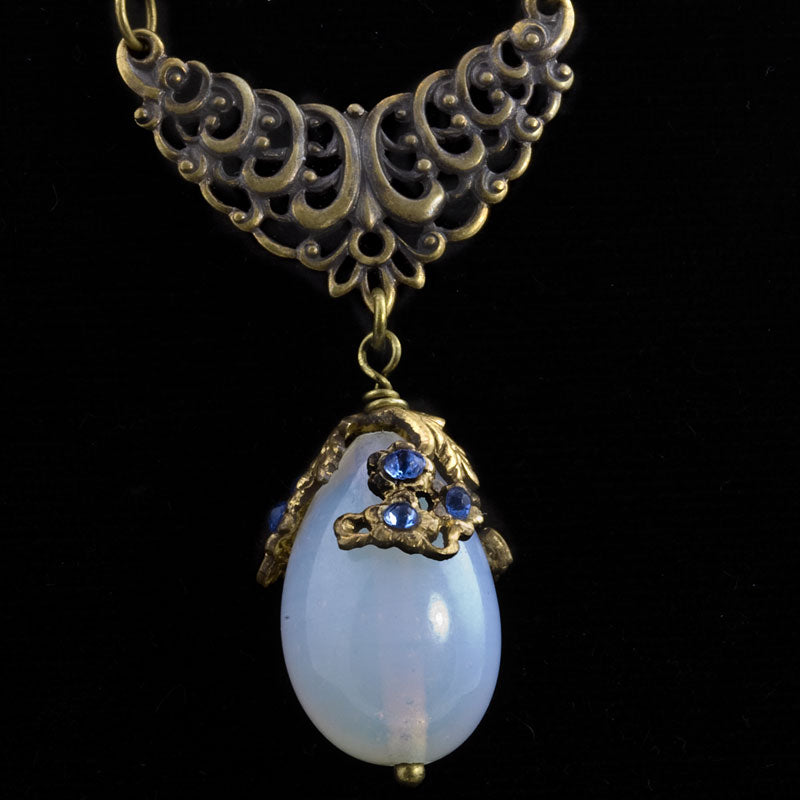 Edwardian style sautoir necklace of vintage opal glass and brass bar chain. nlbg2006e
