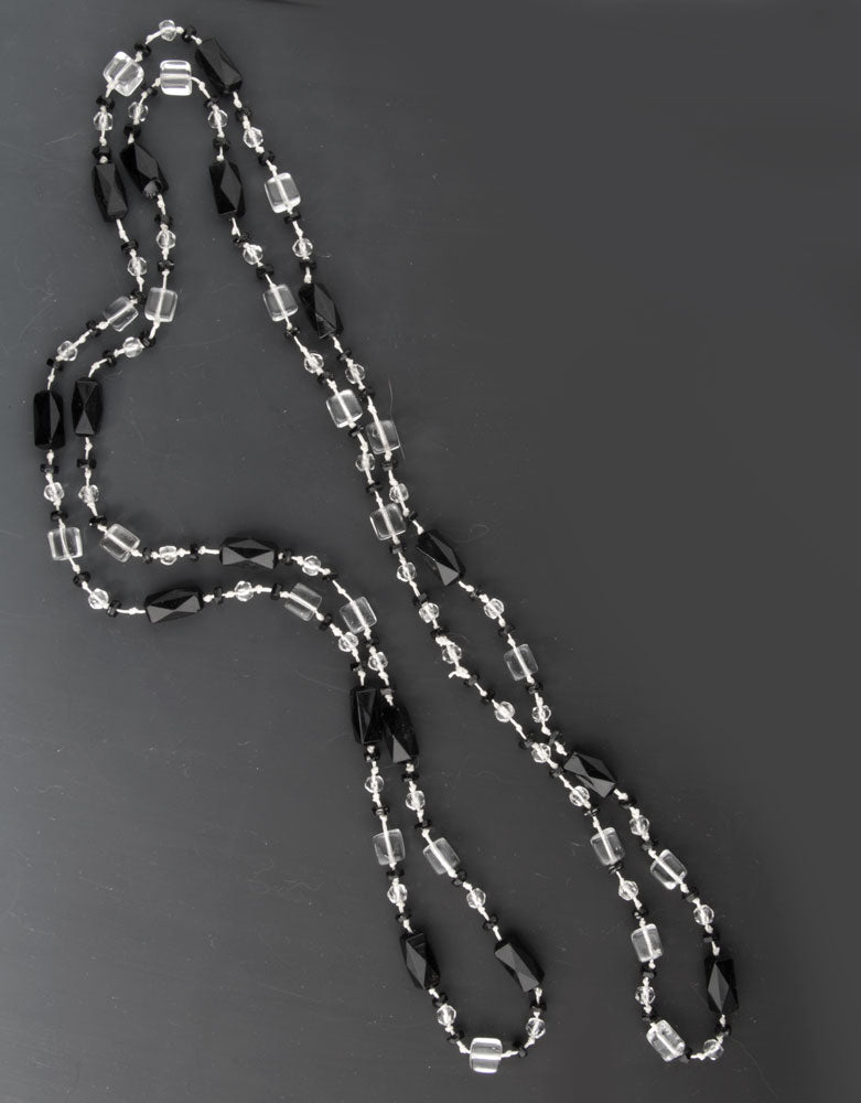 Early Art Deco Bohemian black and clear glass flapper length necklace. nlbg2069e