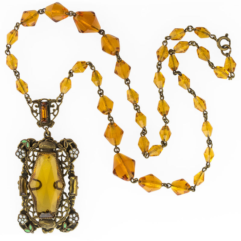 Antique Art Nouveau Bohemian amber glass and white & green enameled brass lavaliere necklace. nlbg2084