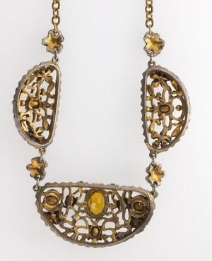 Vintage 1930's-40's cast brass link necklace with prong set glass stones and applied brass flowers. nlbg2092