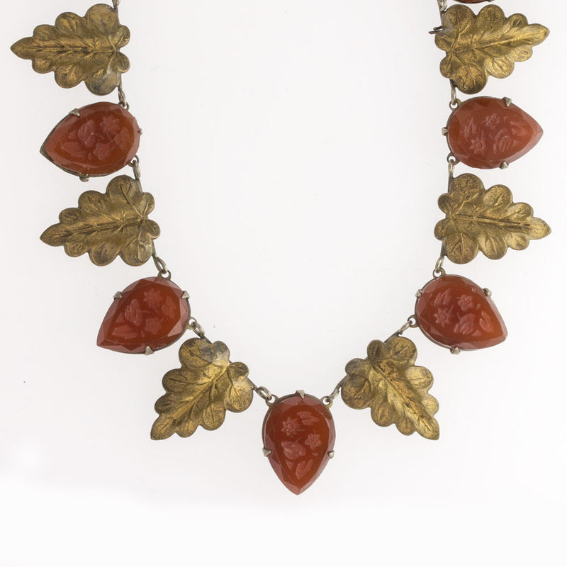 Bohemian necklace of stamped brass leaves and prong-set carnelian glass pressed glass stones Czechoslovakia c. 1920-1925. nlbg2107(e)