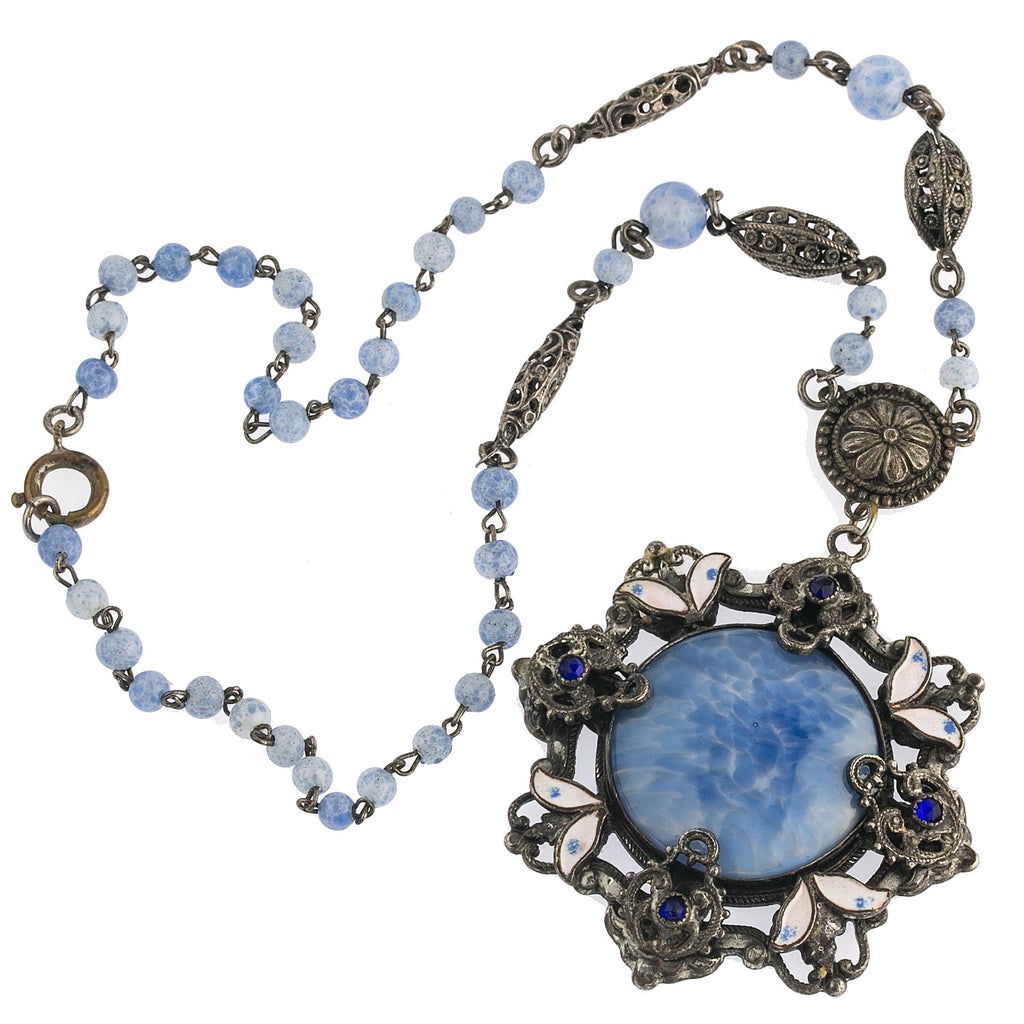 Antique Art Nouveau Bohemian glass silver metal filigree lavaliere necklace with blue satin glass and silver metal enameled setting. nlbg2148