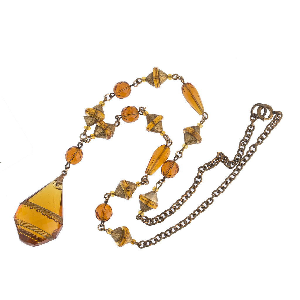 1920s Bohemian etched amber glass pendant necklace. nlbg2155