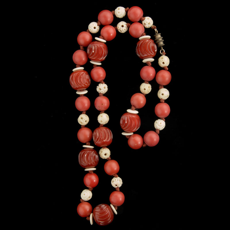 Vintage necklace of carved Galalith beads and bone beads. nlbk796(e)