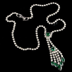 Vintage  lavaliere necklace of  clear rhinestones with emerald green accent stones. 1960s. nlcs832