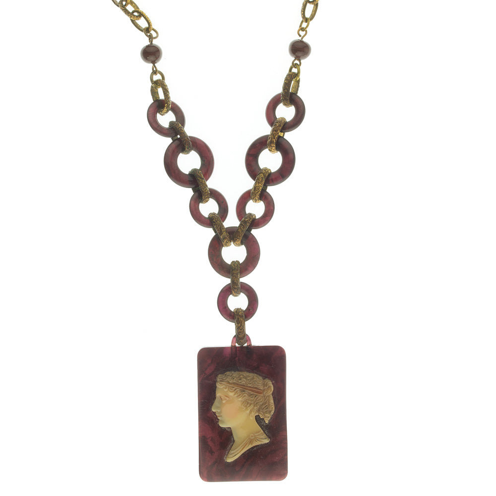 Early century Galalith and embossed gilt brass faux tortoise cameo necklace. nled477e