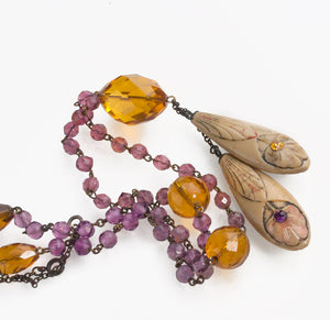 Edwardian faceted glass negligee necklace with carved celluloid pendants. nled489e