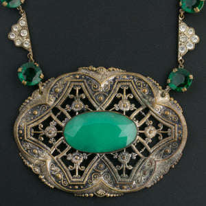 Early 20th century green glass and fancy stamped brass pendant necklace. rhinestone green glass chain and brass chain. Bohemia .nled497