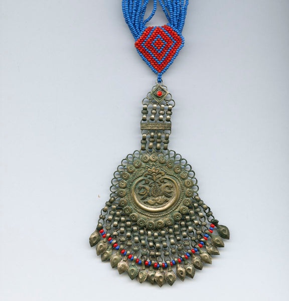 An antique Persian silver pendant with antique seed beads, sherpa coral and silver chain. nlet802(e)