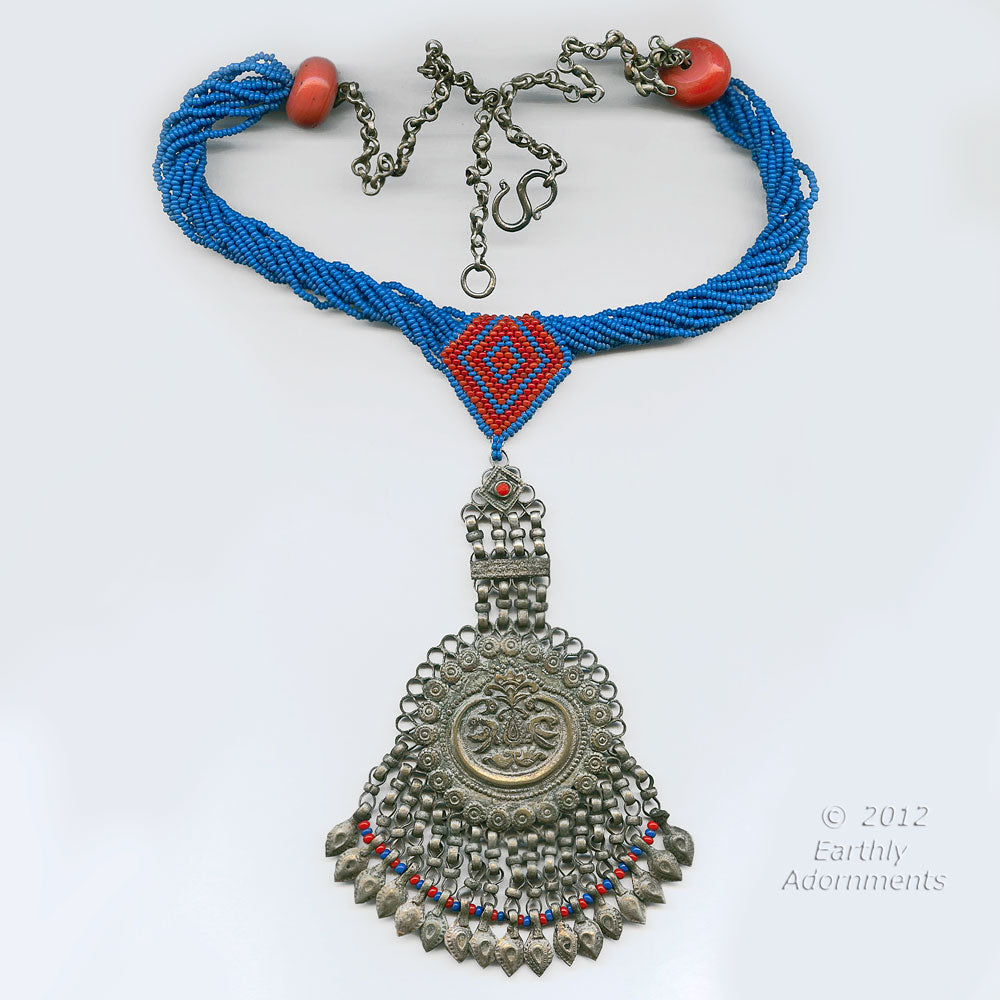 An antique Persian silver pendant with antique seed beads, sherpa coral and silver chain. nlet802