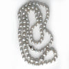 Vintage silver semi baroque Akoya pearl necklace. 33 inches. nlfn113
