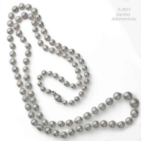 nlfn113(e)-Vintage silver semi baroque Akoya pearl necklace. 33 inches.