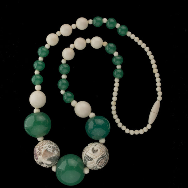 Necklace of antique Japanese polychrome scrimshaw ox bone Ojime beads and antique Chinese Peking glass beads. nliv868
