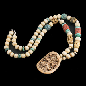 Antique Tibetan carved bone ornament with vintage turquoise, coral, yak bone and silver bead necklace.  nliv873