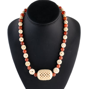 Necklace of rare antique intricately hollow carved Chinese Cantonee bone beads and vintage natural Carnelian  beads.  nliv875