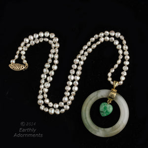 Vintage estate necklace of Japanese freshwater pearls and white and green jadeite pendant. nlja869