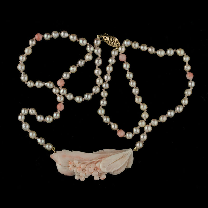 Necklace of Japanese Akoya 4mm pearls and carved angel skin coral. nlja879e