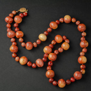 Beautiful vintage graduated genuine Apple Coral knotted bead necklace. 21 inches.  nlja906