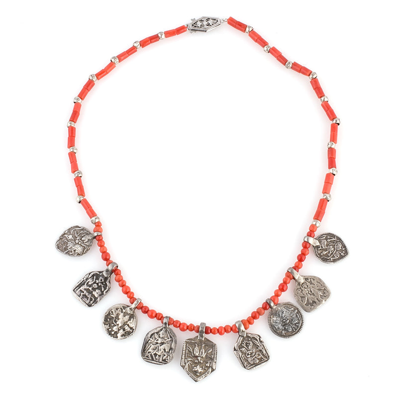 Necklace of carved dark salmon coral round and cylinder beads with 9 antique Hindu sheet silver plaque amulets nlja908