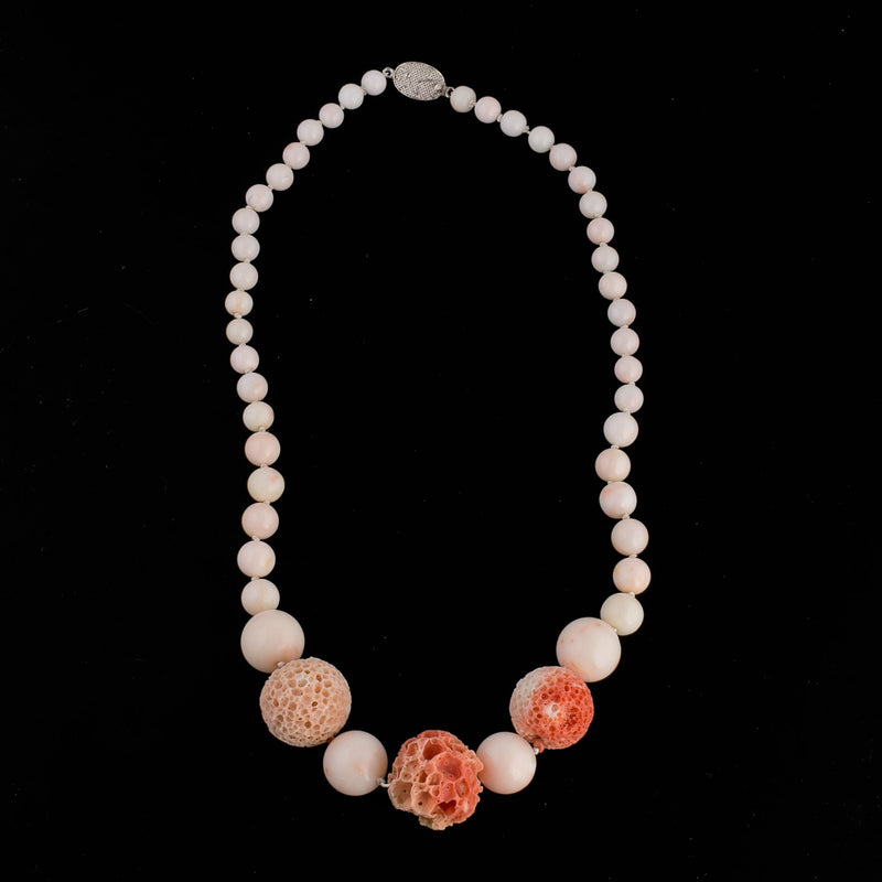 Necklace of vintage graduated fine blush Angelskin coral beads. Sterling clasp. 19in. nlja910