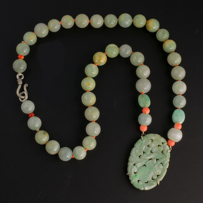 Vintage silver bezel-set Chinese carved Jadeite pendant, with Jadeite and coral bead necklace. 19 inches. nlja911