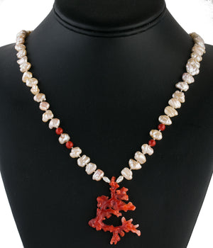 Necklace of vintage Japanese Lake Biwa pearls, oxblood coral beads and sculptural red Mediterranean coral branch pendant. nlja914