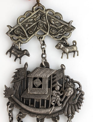 Antique Chinese Qing Dynasty Silver Dragon Boat amulet necklace with silver and coral beads. nlor816cs