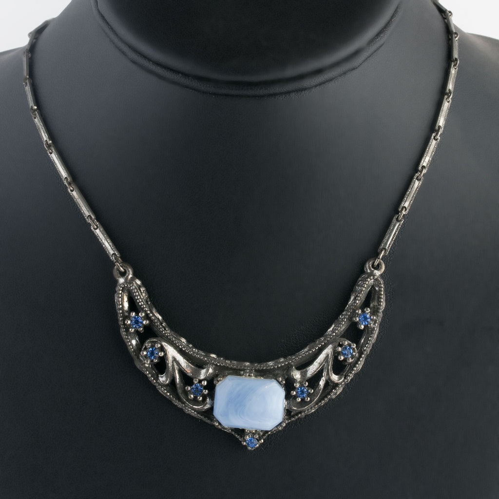 1930s silver metal pendant necklace with blue satin glass and faceted crystal stones.  Silver metal bar chain. nlvn865