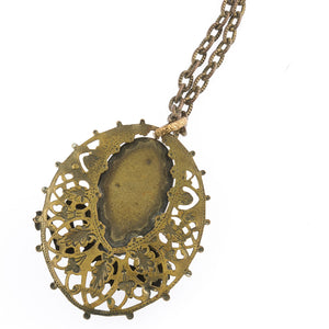 Edwardian brass filigree pendant with satin glass stone and medieval dragon. pded084