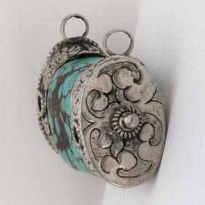 pdet131cs(e)-Vintage Tibetan pendant of turquoise capped with repoussé sterling silver caps
