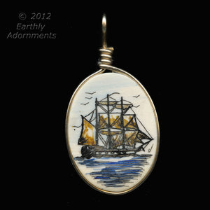 Vintage polychrome handmade ivory scrimshaw pendant in 14k gold-filled wire setting.pdiv836