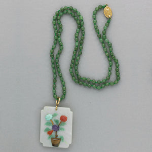 Vintage jade pendant necklace with figural mosaic of applied gemstones and knotted jade bead strand. pdja722(e