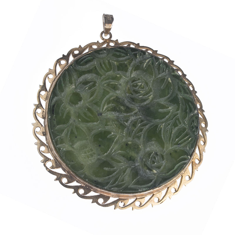 Carved nephrite jade disk floral design in sterling silver vermeil setting with bail. pdja757