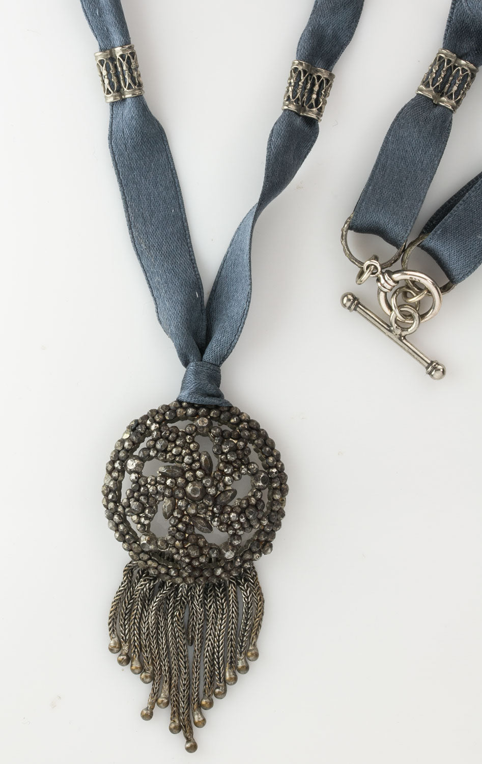Antique French cut steel pendant on satin ribbon with silver ornaments and clasp. pdvc466