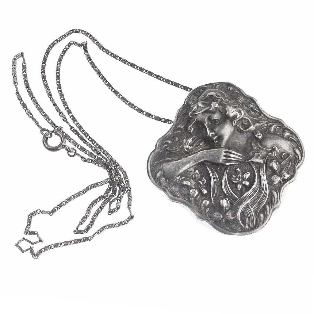 Art Nouveau sterling silver repoussé pendant with sterling silver chain. pdvc468
