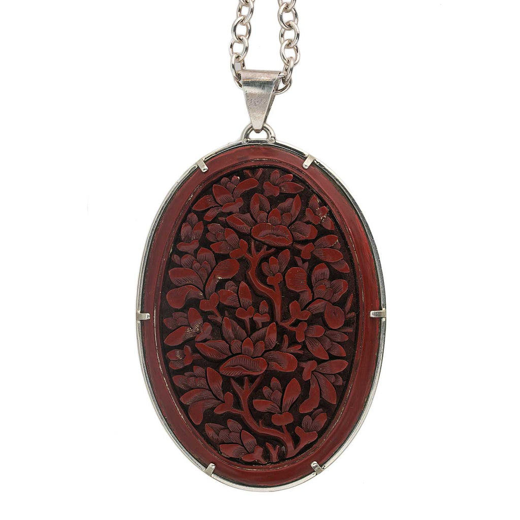 Antique Chinese deep carved dark red cinnabar lacquer carving in sterling silver setting, with sterling chain and old carved nephrite jade beads. pdvs567