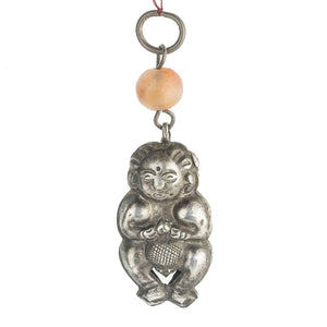 Antique Chinese Qing dynasty hollow coin silver baby amulet with carnelian bead. pdvs659